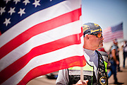 16 JUNE 2010 - PHOENIX, AZ: David Kriete,  from Sierra Vista, a member of the Patriot Guard Riders, waits to greet returning soldiers at the 161st Air Refueling Wing hangar at Sky Harbor Airport in Phoenix Wednesday. Members of the 3666th Maintenance Company of the Arizona Army National Guard returned to Phoenix Wednesday after serving in Iraq.    PHOTO BY JACK KURTZ