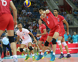07.09.2014, Krakow Arena, Krakau, POL, FIVB WM, Iran vs Puerto Rico, Gruppe D, im Bild FARHAD GHAEMI (P), FARHAD ZARIF (L) // during the FIVB Volleyball Men's World Championships Pool D Match beween Iran and Puerto Rico at the Krakow Arena in Krakau, Poland on 2014/09/07.<br /> <br /> ***NETHERLANDS ONLY***
