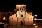 """General view of Church of Santiago, Salamanca, Spain, pictured on December 19, 2010 at night, floodlit. Near the Roman bridge is the plain Romanesque church of Santiago, a modern reproduction (1980) of the original church. Salamanca, an important Spanish University city, is known as La Ciudad Dorada (""""The golden city"""") because of the unique golden colour of its Renaissance sandstone buildings. Founded in 1218 its University is still one of the most important in Spain. Around it the Old Town is a UNESCO World Heritage Site. Picture by Manuel Cohen"""