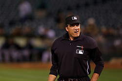 June 28, 2011; Oakland, CA, USA; MLB umpire Phil Cuzzi (10) stands behind home plate during the sixth inning between the Oakland Athletics and the Florida Marlins at the O.co Coliseum.  Oakland defeated Florida 1-0.