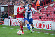 Milan Lalkovic of Walsall attempts to beat Lloyd Isgrove of Barnsley to the ball during the Sky Bet League 1 Playoff Semi Final First Leg at Oakwell, Barnsley<br /> Picture by Matt Wilkinson/Focus Images Ltd 07814 960751<br /> 14/05/2016