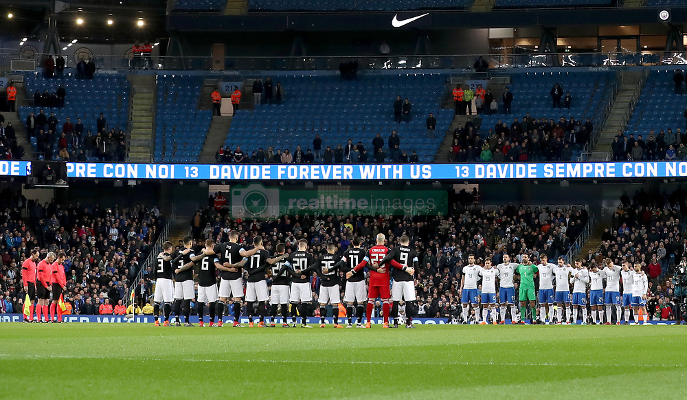 Players observe a minutes silence for footballer Davide Astori during the international friendly match at the Eithad Stadium, Manchester.