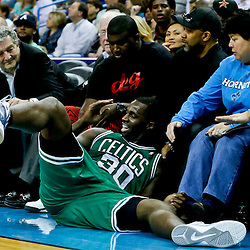 Mar 20, 2013; New Orleans, LA, USA; Boston Celtics power forward Brandon Bass (30) falls into fans sitting courtside during the second quarter of a game against the New Orleans Hornets at the New Orleans Arena. Mandatory Credit: Derick E. Hingle-USA TODAY Sports