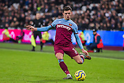 Aaron Cresswell (West Ham) passes the ball during the Premier League match between West Ham United and Arsenal at the London Stadium, London, England on 9 December 2019.