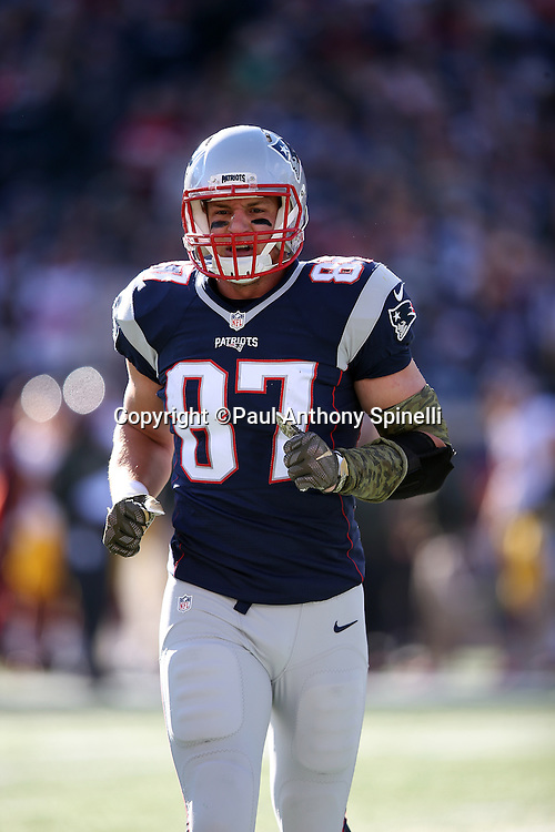 New England Patriots tight end Rob Gronkowski (87) jogs back to the sideline during the 2015 week 9 regular season NFL football game against the Washington Redskins on Sunday, Nov. 8, 2015 in Foxborough, Mass. The Patriots won the game 27-10. (©Paul Anthony Spinelli)