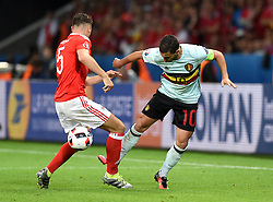 Eden Hazard of Belgium battles for the ball with James Chester of Wales  - Mandatory by-line: Joe Meredith/JMP - 01/07/2016 - FOOTBALL - Stade Pierre Mauroy - Lille, France - Wales v Belgium - UEFA European Championship quarter final