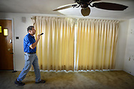 Home inspector Frank Castiglione of Real Estate Inspections, looks at the living room of a home for possible problems Thursday, September 28, 2017 in Plymouth Meeting, Pennsylvania. (WILLIAM THOMAS CAIN / For The Philadelphia Inquirer)