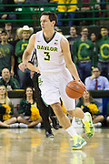 WACO, TX - JANUARY 5: Jake Lindsey #3 of the Baylor Bears brings the ball up court against the Oklahoma State Cowboys on January 5, 2016 at the Ferrell Center in Waco, Texas.  (Photo by Cooper Neill/Getty Images) *** Local Caption *** Jake Lindsey