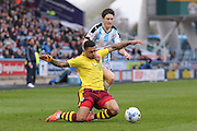 Huddersfield Town midfielder Joe Lolley (18) and Burnley forward Andre Gray (7)  battle it out during the Sky Bet Championship match between Huddersfield Town and Burnley at the John Smiths Stadium, Huddersfield, England on 12 March 2016. Photo by Simon Davies.