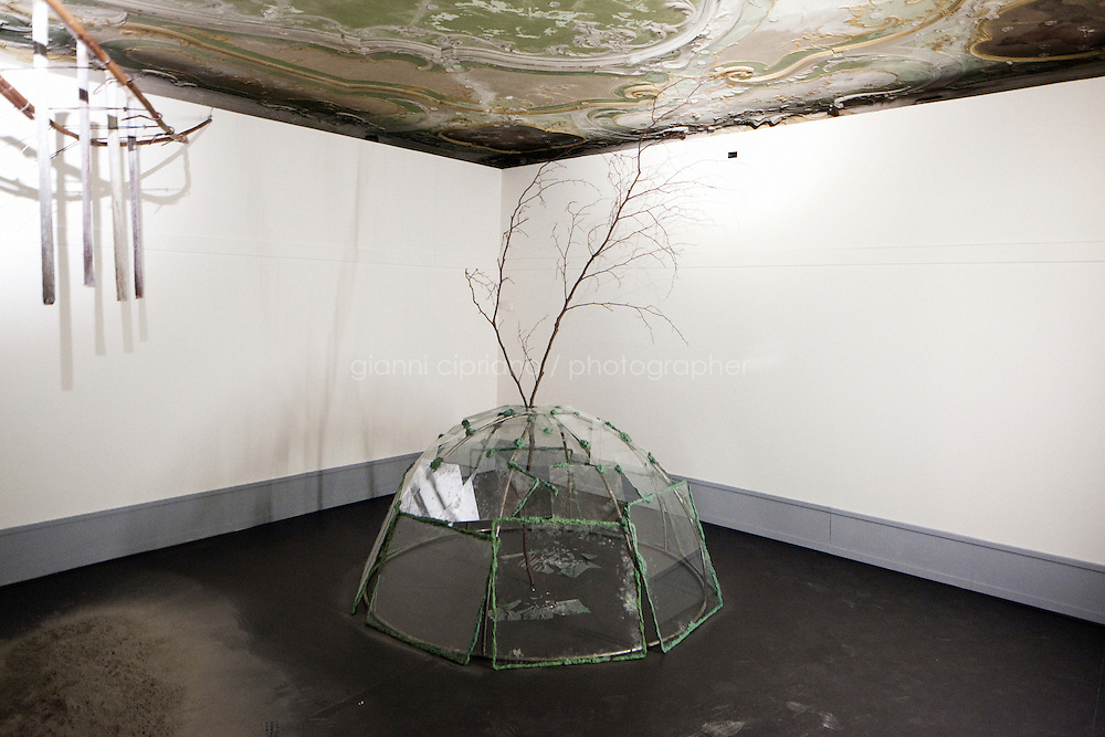 VENICE, ITALY - 28 MAY 2013: Mario Merz's &quot;Acqua scivola (igloo di vetro), 1969&quot; at the Fondazione Prada at the second mezzanine floor of the Fondazione Prada, corresponding to the lower floor of the Kunsthalle Bern,  in Venice, Italy, on May 28th 20113. <br /> <br /> The exhibition &quot;When Attitudes Become Form: Bern 1969/Venice 2013&quot;, curated by Germano Calent in dialogue with Thomas Deman and Rem Koolhas, reconstructs &quot;Live in Your Head. When Attitudes Become Form&quot;, a show curated by Harald Szeemann at the Bern Kunsthalle in 1969, which went down in history for the curator's radical approach to exhibition practice, conceived as a linguistic medium.<br /> The 55th International Art Exhibition of the Venice Biennale takes place in Venice from June 1st to November 24th, 2013 at the Giardini and at the Arsenale as well as in various venues the city. <br /> <br /> Gianni Cipriano for The New York TImes
