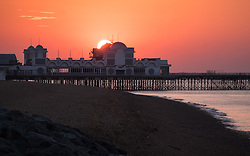 © Licensed to London News Pictures. 14/09/2016. Portsmouth, UK.  Dawn breaks as the sun rises over South Parade Pier in Southsea this morning, 14th September 2016. Temperatures are set to remain warm over the coming days in the south of England. Photo credit: Rob Arnold/LNP