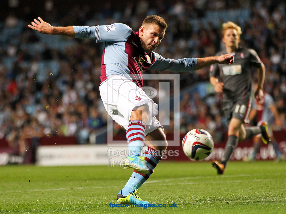 Picture by Tom Smith/Focus Images Ltd 07545141164<br /> 28/08/2013<br /> Andreas Weimann of Aston Villa takes a shot during the Capital One Cup match at Villa Park, Birmingham.