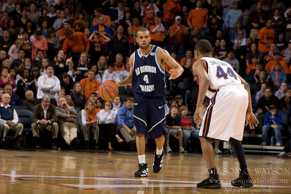 Old Dominion guard Brandon Johnson (4) dribble up court with the game tied at 75 in the final seconds of the game.  Seconds later, Virginia guard Sean Singletary (44) stole the ball on a crossover dribble and took it the length of the court to score the game winning basket with 4.3 seconds remaining.  The Virginia Cavaliers men's basketball team defeated the Old Dominion Monarchs 80-76 in the second round of the College Basketball Invitational (CBI) at the University of Virginia's John Paul Jones Arena in Charlottesville, VA on March 24, 2008.