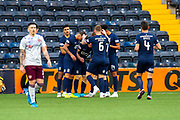 Chris Burke (#29) of Kilmarnock FC is mobbed by team mates after scoring the opening goal during the Ladbrokes Scottish Premiership match between Kilmarnock FC and Heart of Midlothian FC at Rugby Park, Kilmarnock, Scotland on 23 November 2019.