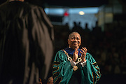 President McDavis applauds during faculty during Undergraduate Commencement. Photo by Ben Siegel