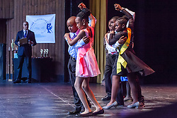 "Dober and E. Benjamin Oliver students compete with the Tango.  Dancing Classrooms Virgin Islands students compete in ""Colors of the Rainbow"" team match competition at Reichhold Center for the Arts.  St. Thomas, USVI.  9 May 2015.  © Aisha-Zakiya Boyd"