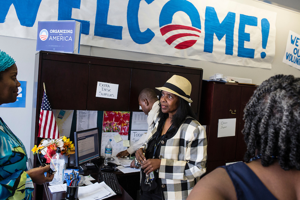 Sandra Antoine, center, a volunteer with Organizing for America, President Obama's re-election campaign arm, works the front desk in the group's Richmond headquarters on Thursday, May 3, 2012 in Richmond, VA.