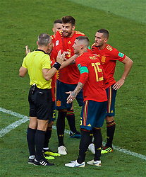 MOSCOW, RUSSIA - Sunday, July 1, 2018: Spain's Gerard Pique and Sergio Ramos argue with referee Bjorn Kuipers after he awarded Russia a penalty during the FIFA World Cup Russia 2018 Round of 16 match between Spain and Russia at the Luzhniki Stadium. (Pic by David Rawcliffe/Propaganda)