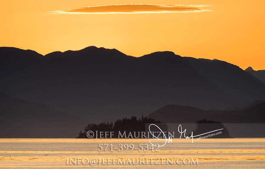 Sunrise over the mountains along Queen Charlotte Strait in British Columiba, Canada.