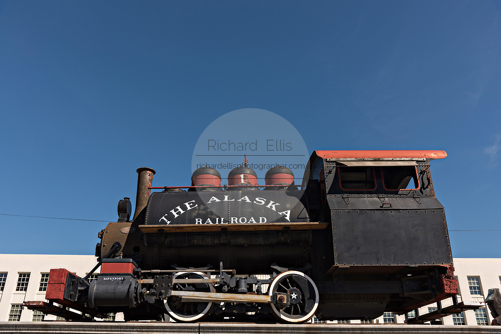 An old coal steam engine displayed outside the Alaska Railroad depot in downtown Anchorage, Alaska.  The Moderne-style railroad station was built in 1942 and is the starting point of the Denali Star luxury train.