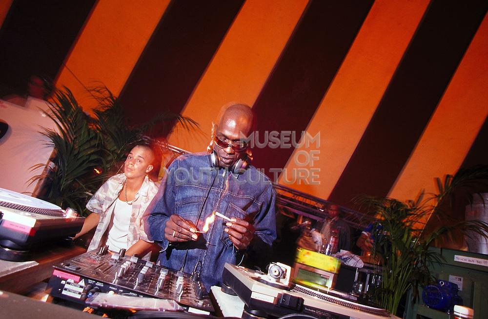 Drum & Bass DJ Fabio lighting a spliff DJ'ing at Dance Valley Holland August 2002