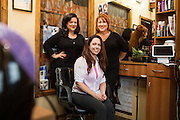 Chava Pelo Salon owner Bobbie Chavarria, right, and associates pose for a portrait at Chava Pelo Salon in Milpitas, California, on July 19, 2015. (Stan Olszewski/SOSKIphoto)