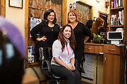 Chava Pelo Salon owner Bobbie Chavarria, right, and associates pose for a portrait at Chava Pelo Salon in Milpitas, California, on July 19, 2015. (Stan Olszewski/SOSKIphoto)
