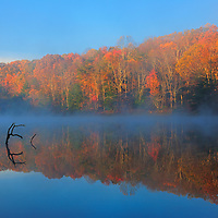 Rose Lake in the Hocking Hills State Park on a foggy morning in the fall.