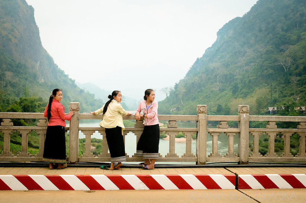 Laos, Nong Khiaw. Three Lao women on the bridge.