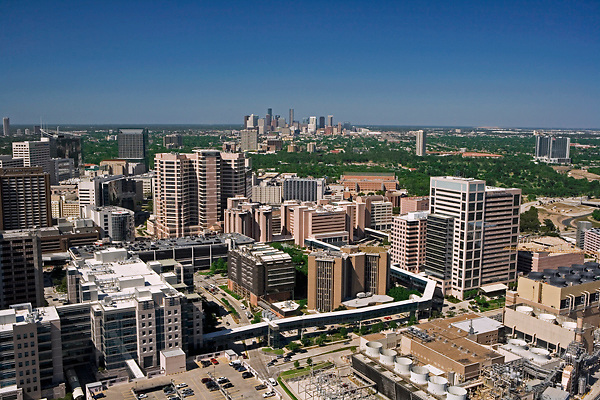 Aerial view of Texas Medical Center featuring MD Anderson Cancer Center Campus in the foreground with Houston, Texas skyline in the distance.