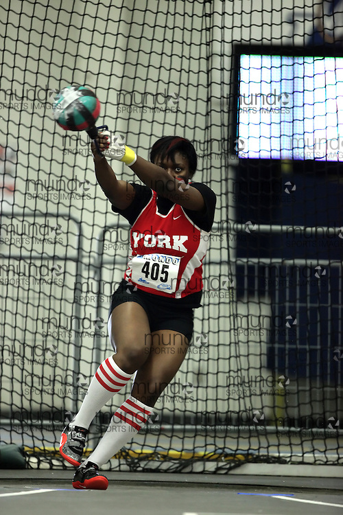 (Windsor, Ontario---11 March 2010) Cynthia Appiah of York University Yoemen competes in the  competes in the weight throw at the 2010 Canadian Interuniversity Sport Track and Field Championships at the St. Denis Center. Photograph copyright Geoff Robins/Mundo Sport Images. www.mundosportimages.com
