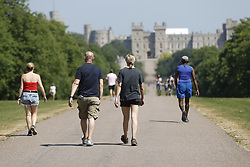 © Licensed to London News Pictures. 30/05/2020. Windsor, UK. People exercise on The Long Walk near Windsor Castle as the sun shines. The government have announced new measures from Monday to allow groups of six people to meet outdoors. Photo credit: Peter Macdiarmid/LNP