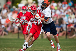 Virginia Cavaliers LSM Mike Timms (44) collides with Cornell Big Red M Max Seibald (42).  The #1 ranked Virginia Cavaliers defeated the #4 ranked Cornell Big Red 14-10 at Klockner Stadium on the Grounds of the University of Virginia in Charlottesville, VA on March 8, 2009.