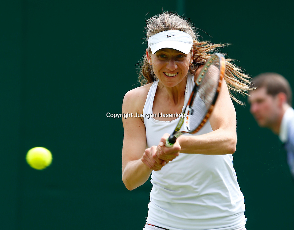 Wimbledon Championships 2013, AELTC,London,<br /> ITF Grand Slam Tennis Tournament, Mona Barthel (GER),Aktion,Einzelbild,Halbkoerper,Querformat,