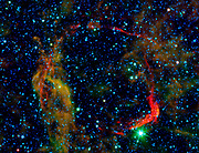Infrared images from NASA's Spitzer Space Telescope and WISE are combined in this image of RCW 86, the dusty remains of the oldest documented example of an exploding star, or supernova.