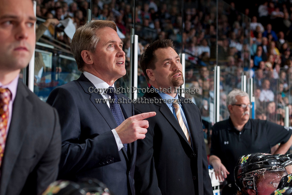 KELOWNA, CANADA - APRIL 25: Mike Johnston, head coach and Karl Taylor, assistant coach of the Portland Winterhawks stand on the bench against the Kelowna Rockets on April 25, 2014 during Game 5 of the third round of WHL Playoffs at Prospera Place in Kelowna, British Columbia, Canada. The Portland Winterhawks won 7 - 3 and took the Western Conference Championship for the fourth year in a row earning them a place in the WHL final.  (Photo by Marissa Baecker/Getty Images)  *** Local Caption *** Mike Johnston; Karl Taylor;