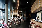 Snack bar on the buildings ground floor.The City of Wine, Bordeaux, France. Architect: CitÈ du vin in Bordeaux ;  Atelier 16- Architectures, Laurent Karst; 2016.