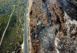 November 11, 2019 - Aerial photo shows burnt bushes near Port Macquarie, New South Wales, Australia. A devastating start to the Australian bushfire season has prompted a state of emergency in the eastern state of New South Wales (NSW), with the country's largest city, Sydney bracing for ''catastrophic'' fire danger. .   On Monday, a state of emergency was declared for NSW, with exceptionally hot and windy conditions predicted for Tuesday, threatening to create an even bigger fire disaster than that which left three people dead last week. (Credit Image: © Bai Xuefei/Xinhua via ZUMA Wire)
