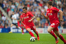 PRESTON, ENGLAND - Saturday, July 19, 2014: Liverpool's Philippe Coutinho Correia in action against Preston North End during a preseason friendly match at Deepdale Stadium. (Pic by David Rawcliffe/Propaganda)