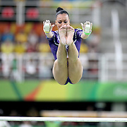 Gymnastics - Olympics: Day 2  Lorrane Oliveira #315 of Brazil in action on the Women's Uneven Bars during the Artistic Gymnastics Women's Qualification round at the Rio Olympic Arena on August 7, 2016 in Rio de Janeiro, Brazil. (Photo by Tim Clayton/Corbis via Getty Images)