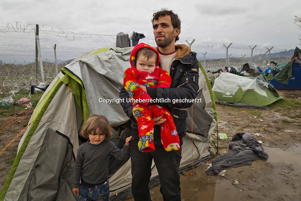 Greece, Idomeni, Refugees on their way to Europe - Eye of a Needle, Idomeni<br /> <br /> Syrian-Kurdish father with his kids has his tent close to the borderfence, waiting the Mazedonia opens the border.<br /> <br /> Nadeloehr nach Nordeuropa Idomeni, der Grenzuebergang ist seit Tagen gesperrt,. <br /> Es ensteht im provisorischen Fluechtlingslager in Idomeni eine ngespannte Lage. <br /> Daueregen und Kaelte machen vor allem den Familien mit kleinen Kindern zu schaffen. <br /> <br /> Idomeni, is the eye of a needle for getting to nothern Europe. <br /> The FYRO macedonian authorities, closed the border from Greece completely. The situation close to the border gets more and more difficult. The People have to sleep outside or in small tents. <br /> Heavy rainfalls and cold nights are treating the refugees badly. Some already stayed up to ten nights at Idomeni. There is not enough food and supplies to help about 14.000 refugees.<br /> <br /> <br /> <br /> keine Veroeffentlichung unter 50 Euro*** Bitte auf moegliche weitere Vermerke achten***Maximale Online-Nutzungsdauer: 12 Monate !! <br /> <br /> for international use:<br /> Murat Tueremis<br /> C O M M E R Z  B A N K   A G , C o l o g n e ,  G e r m a n y<br /> IBAN: DE 04 370 800 40 033 99 679 00<br /> SWIFT-BIC: COBADEFFXXX