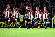 Brentford striker, Scott Hogan (9) celebrating scoring 2-0 during the Sky Bet Championship match between Brentford and Cardiff City at Griffin Park, London, England on 19 April 2016. Photo by Matthew Redman.