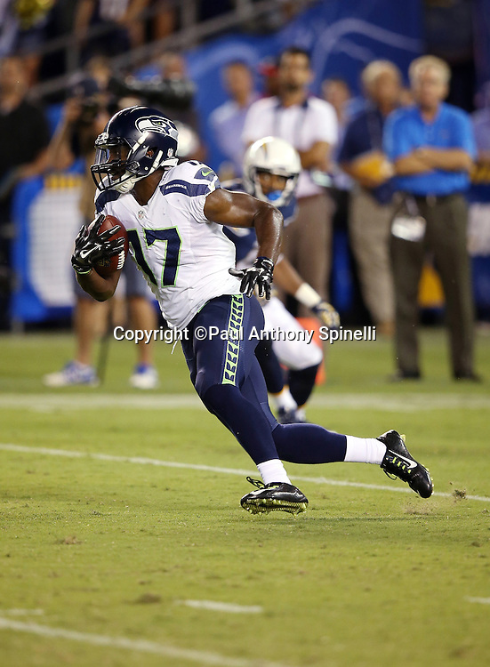 Seattle Seahawks wide receiver and punt returner Kevin Smith (17) returns a punt during the 2015 NFL preseason football game against the San Diego Chargers on Saturday, Aug. 29, 2015 in San Diego. The Seahawks won the game 16-15. (©Paul Anthony Spinelli)