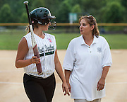 Brianna Fisher talks to her coach after the first inning during a game against Gibbstown held at the Clayton Little League Complex Thursday July 7, 2011.