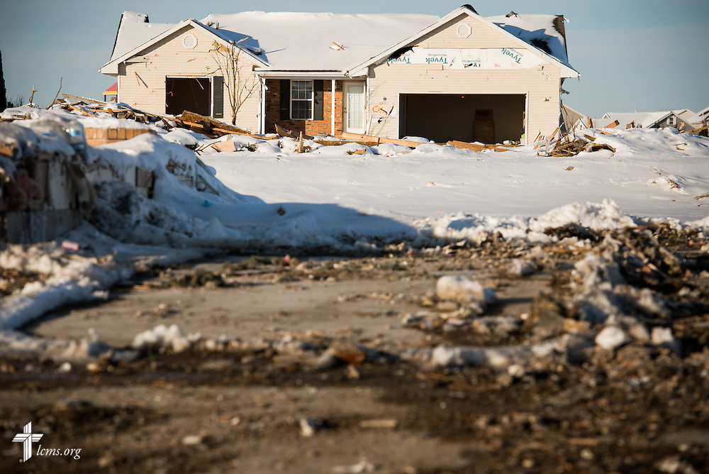 A gutted home sits empty in a damaged neighborhood of Washington, Ill., on Wednesday, Dec. 18, 2013. Nearly two dozen tornadoes plowed through Illinois in November, killing a total of seven. LCMS Communications/Erik M. Lunsford