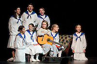 "Grace McLaughlin as Maria Rainer teaches the Von Trapp children (top row) Heather Hunt (Liesl), Roland DuBois Friedrich and Nate Drouin (Kurt)   (bottom row) Kaia Langathianos (Gretl), Emily Hanf (Brigitta), Grace Mclaughlin (Maria), Caitlin Houston (Louisa) and Cat McLaughlin (Marta) to sing  ""Do Re Mi"" during Wednesday evenings dress rehearsal at Gilford High School.  (Karen Bobotas/for the Laconia Daily Sun)"