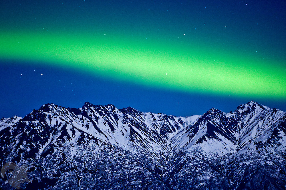A band of Aurora stretches over the Chugach Range and the Knik River Valley, near Palmer, Alaska on February 27, 2007.