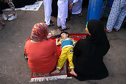 Image ©Licensed to i-Images Picture Agency. 28/07/2014. Cairo, Egypt. <br /> 61981784<br /> A boy sleeps on the floor of the mosque during the Eid al-Fitr celebration in Cairo, Egypt, on July 28, 2014. Egyptian Muslims on Monday celebrate the Eid al-Fitr festival that marks the end of the fasting month of Ramadan.. Picture by  imago / i-Images<br /> UK ONLY