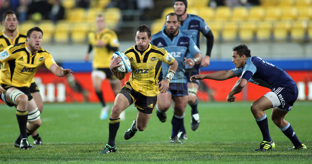 AAron Cruden makes a break. Super Rugby - Hurricanes v Blues at Westpac Stadium, Wellington, New Zealand on Friday 6th May 2011. PHOTO: Grant Down / photosport.co.nz