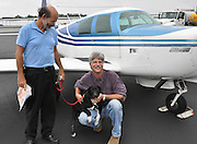 20090916  -  Athens, Ga : Rescue dog Oreo, a six-month-old female border collie, gets her first airplane ride with Atlanta pilot David Tulis and Skybound flight instructor Michael O'Neal on a route from Athens, Ga. to south Homerville airport in south Georgia via single engine Mooney airplane on Thursday September 17, 2009.  (http://www.pilotsnpaws.org)  David Tulis         dtulis@gmail.com    ©David Tulis 2009
